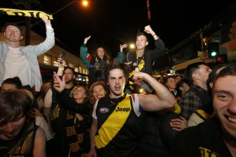 Richmond fans celebrate in Swan Street after the 2019 AFL grand final.