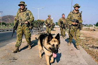 Australian soldiers patrol Dili.