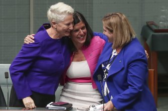 Kerryn Phelps, Julia Banks and Rebekha Sharkie celebrate after the medevac bill passes the House of Representatives.