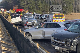 In this photo provided by the Virginia State Police, emergency personnel work at the scene of the multi-vehicle pileup.