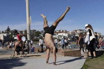 People exercise at Bondi Beach.