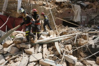 Emergency workers search a collapsed building in Beirut, Lebanon.