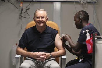 Opposition Leader Anthony Albanese receives a COVID-19 vaccination.