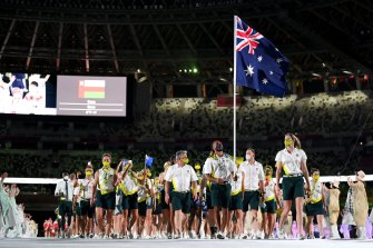 Flag bearers Cate Campbell and Patty Mills lead Team Australia out during the Opening Ceremony.