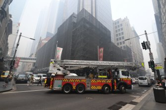 Firefighters attend scores of call outs at buildings across the city after the smoke triggered fire alarms.