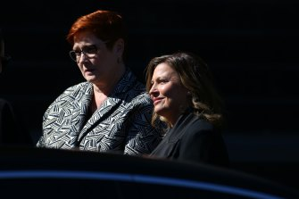 Marise Payne and Jenny Morrison arrive at the state funeral for Carla Zampatti at St Mary's Cathedral.