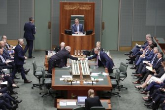 Democracy at work: Prime Minister Scott Morrison reaches across the table to shake hands with Opposition Leader Anthony Albanese.
