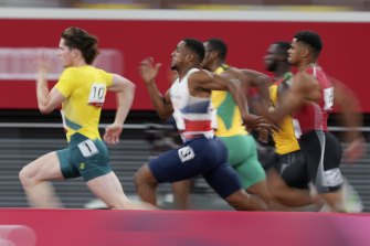 Rohan Browning, left, of Australia, leads the field in his heat of the men's 100m.