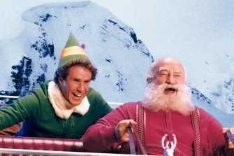 Asner as Santa Claus, right, with Will Ferrell in Elf.