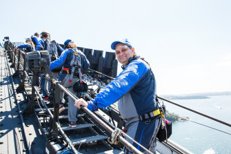 Artistic director Wesley Enoch climbs the Sydney Harbour Bridge as part of a Sydney Festival event called Burrawa.