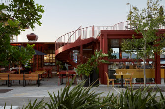 The blood-red oxide pavilion and awning, with its expressed streel beams, gives a subtle nod to the past.