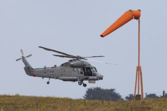 A Royal New Zealand Air Force helicopter takes off from Whakatane Airport to return to White Island.