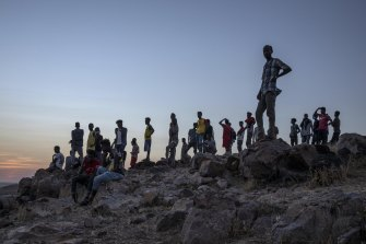 Tigray people who fled the conflict in Ethiopia's Tigray region, stand on a hill top overlooking Umm Rakouba refugee camp in Qadarif, eastern Sudan, on Thursday.