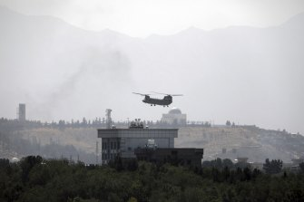 On Sunday, as the Taliban trucks rolled through the streets, Chinook helicopters started evacuating the US embassy while smoke from burning documents rose into the sky.