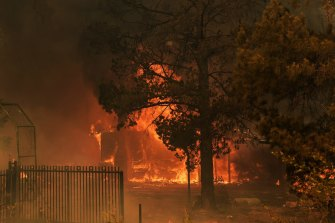 A house on fire that could not be saved in the fires on the outskirts of Bargo, NSW.