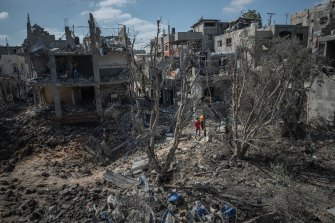 People inspect the damage in Beit Hanoun, Gaza City, after a night of Israeli raids.