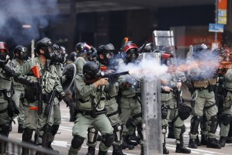 Police fire tear gas to disperse anti-government protesters in Hong Kong on Tuesday.