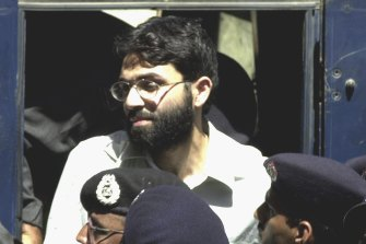 Ahmed Omar Saeed Sheikh, the alleged mastermind behind Wall Street Journal reporter Daniel Pearl's abduction, arrives at a court in Karachi, Pakistan, in 2002.