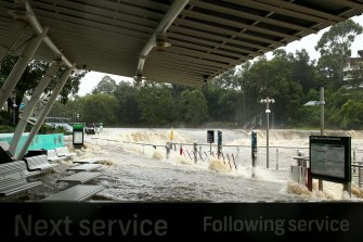 Parramatta ferry wharf overflows and floods due to continuous and heavy rain on Saturday.