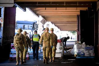 Victoria Police and ADF personnel patrolling Melbourne CBD during the stage four COVID-19 lockdown.