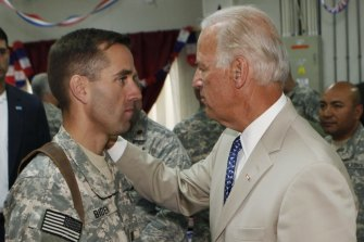 Joe Biden talking with then US Army Captain Beau Biden, at Camp Victory on the outskirts of Baghdad, Iraq in 2009.