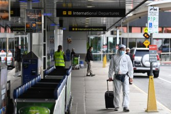 A man in personal protective equipment outside the international departures terminal at Melbourne Airport last week.