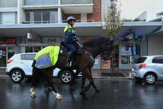 NSW Mounted Police patrol the streets of Fairfield during the lockdown.
