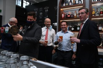 Sydney-siders are calling it 'Freedom Day' after restrictions were lifted at midnight last night. NSW Premier Dominic Perrottet (right) with NSW Deputy Premier Paul Toole and NSW Treasurer Matt Kean at Watson's Pub in Moore Park today.