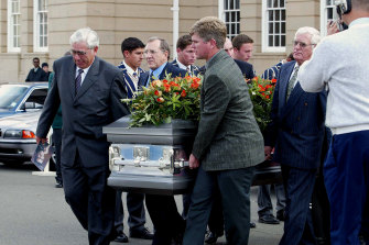 Hansie Cronje's father Ewie, left, and Cronje's only brother, Frans, right, carry his coffin.