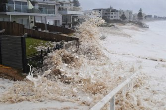 Sea foam whipped up by the strong surf inundates properties along Collaroy on Sydney's northern beaches on Monday.