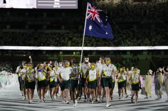 Flag bearers Patty Mills and Cate Campbell lead the Australian team into the stadium during the opening ceremony.