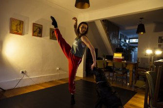 Sydney Dance Company Dancer Mia Thompson with her dog Pepe in her living room.