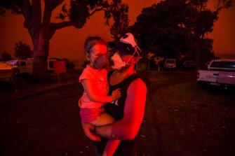The sky in Mallacoota turned blood red on January 4, when a south-westerly wind change flared up flames. Mike and his daughter Elsie were still trapped in the tiny coastal town five days after the first fire ripped through.