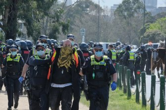 Police making arrests at Freedom Day Protest rally in Albert Park on September 5.