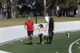A family take a stroll AT Gore Hill Oval in St.Leonards, during lockdown.