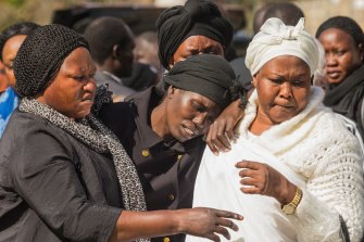 Akon Guode at her children's funeral in April 2015.