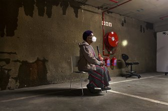 A woman waits to be tested for COVID-19 in a shopping centre car park in Johannesburg.