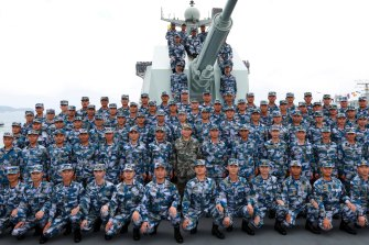 Chinese President Xi Jinping, center in green military uniform, poses with soldiers on a navy ship after he reviewed his navy fleet in the South China Sea in 2018 China has conducted several live-fire military exercises in the Taiwan Strait amid heightened tensions over increased American support for Taiwan.