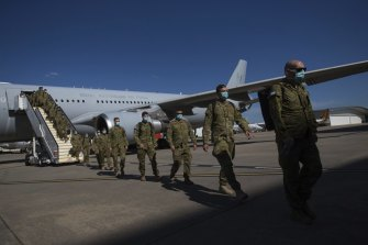 A contingent of ADF personnel arrive in Melbourne from Townsville in December.