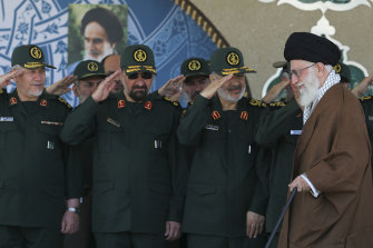 Former commander of the Revolutionary Guard Mohsen Rezaei, second left, is considered a serious contender in Iran's forthcoming presidential elections. Seen here saluting Supreme Leader Ayatollah Ali Khamenei, right, in 2019.