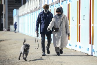 Wellington residents take their dog for a walk during a level-four lockdown  on Thursday.