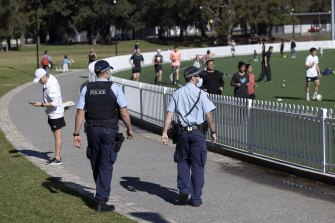 Police patrol at Gore Hill Oval in St Leonards on Saturday.