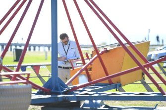 WorkSafe inspectors examine the Cha Cha carnival ride at Rye.