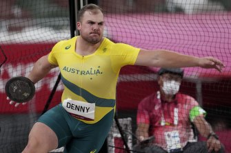 Matthew Denny competes in the discus final.