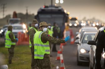 Soldiers assist Victoria Police on a roadside checkpoint on the Geelong Freeway as Melbourne went into lockdown in mid-July.