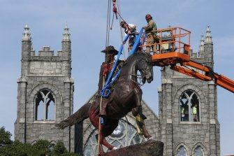Crews work to remove a statue of Confederate general J.E.B. Stuart from Richmond's Monument Avenue on July 7.