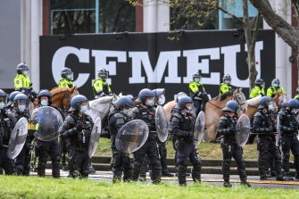 Police were forced to guard the CFMEU office in Melbourne after the protests. They are also among the next groups who will have vaccination mandated.