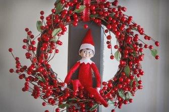 The Elf on the Shelf spies on children for Santa.