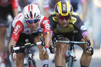 Caleb Ewan, left, edges out Dylan Groenewegen, right, to win his maiden Tour de France stage in Toulouse.