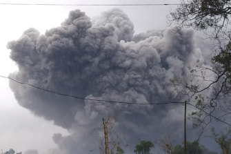 In this photo released by Indonesia's National Disaster Mitigation Agency (BNPB) Mount Semeru spews volcanic material during an eruption in Lumajang, East Java, Indonesia, Saturday, January 16.